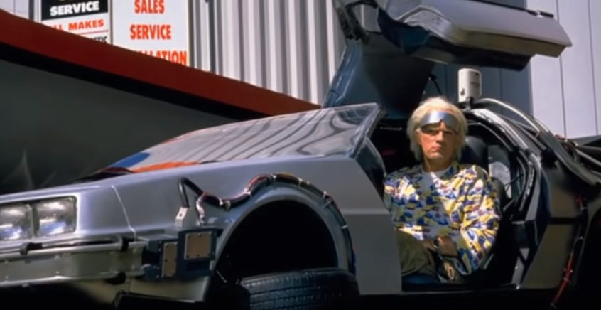 Doc Brown sitting in the flying DeLorean
