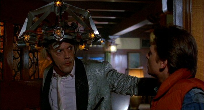 Doc Brown wearing his mind reading helmet looks shocked to see Marty