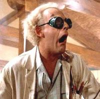 Doc Brown shocked, wearing dark sunglasses